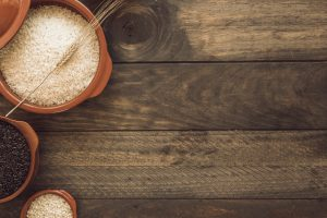 overhead-view-of-healthy-rice-grain-bowls-on-wooden-table